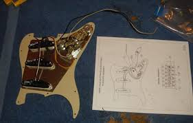 rewiring a squier� stratocaster� with fender� pickups amateur Fender Squier Guitar Wiring Diagram now that the wiring's done, i have a fully loaded pickguard with hot fender pickups ready to install in the body fender squier bullet strat wiring diagram