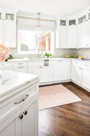 white and gray kitchen with pink medallion rug