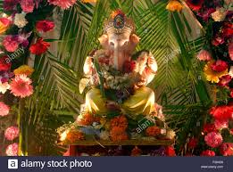 idol of lord ganesh with decoration of flowers worshiping for