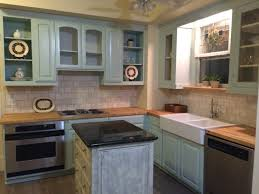 green wooden kitchen cabinet with white sink and stove plus oven combined white wooden
