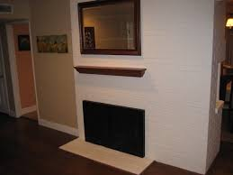 flat screen tv over fireplace ideas for making it look nice