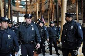 police carrying plastic handcuffs enter the winter garden of the world financial center where occupy wall
