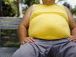 Image result for fat guy sitting on table