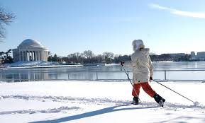 photo essay dc transforms in the snow   images from storms past  a young woman breaks out her cross country skis so she can zip by the
