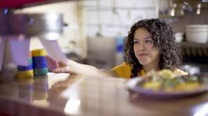 first jobs tips for teens learning attention issues adhd teen worker checking a ticket at a restaurant