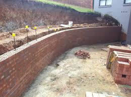 2 level brick retaining wall under construction retaining wall construction