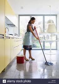 Mopping Kitchen Floor Young Woman Mopping Kitchen Floor Stock Photo Royalty Free Image