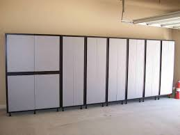 Large Black And White Storage Cabinet With Doors And Black Legs On
