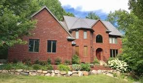 Front View Of Brick House With New Steel Shingles