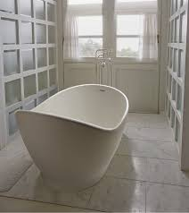 savoy freestanding tub with built in pedestal slotted overflow and with traditional tub filler