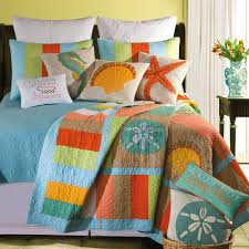 beach themed bedding with flower pot and small wooden table for placed bedroom ideas