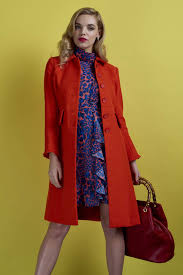 model wearing leopard print dress and boden coat