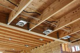 can i cover downlights with insulation