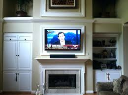 tv above fireplace where to put cable box where to put cable box when mounting over