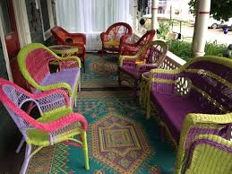 refurbished spray painted wicker chairs bright colors colorful porch
