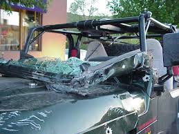the windshield was not much to look at given how badly the frame was crushed it does extend a bit above the roll bar i have no doubt what so ever that