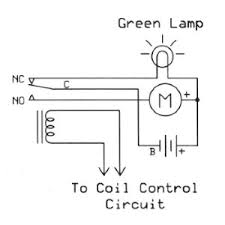 a circuit that uses a relay to switch power to a light relay un energized or to a motor relay energized