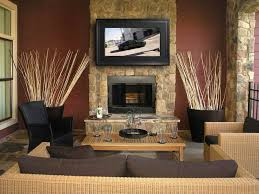 living room stone fireplace with tv above ideas living room wall decor outstanding