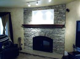 arched stone fireplace rought sne all surrounds