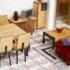 a small dining and living room in a doll house build dollhouse furniture