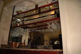 wet bar with glass shelveirrored backdrop
