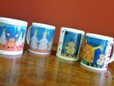 skodelice z motivi tradicionalnih pustnih mask iracije iz slikanice mali ku cups with museum carnival maskture bookscupstraditional