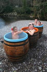 items similar to wood fired whiskey barrel hot tub on