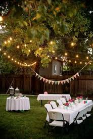 romantic backyard party decorations mixed with round table and rectangle table with clean white table