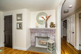 how to whitewash a brick fireplace using only paint and water