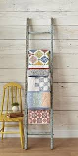 How to Decorate with Vintage Ladders {20 Ways to Inspire ... & Vintage Ladder Quilt Rack Adamdwight.com
