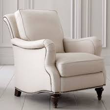 most comfortable reading chair in white with simple design together with  hardwood floor and wooden wall