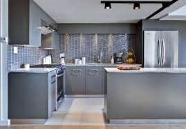 kitchen grey kitchen cabinets with white countertops breakfast bar and countertop brown laminate wooden floor