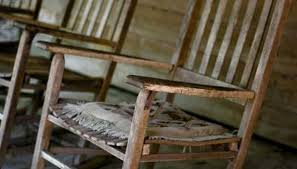 three antique rocking chairs with straight lines