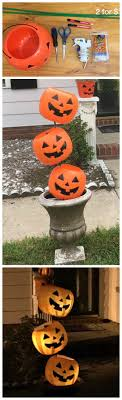 Make a plastic pumpkin pail tipsy decoration for Halloween! Such a cheap  and easy craft