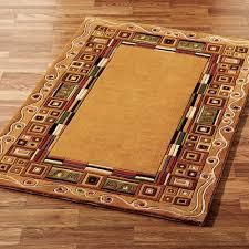 inlaid border area rug gold
