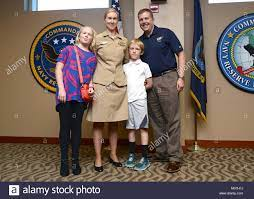 Lieutenant Commander Kerri Chase pose for a family photo following Stock  Photo - Alamy