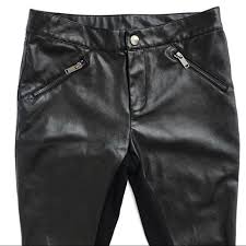 pair of cotton blend woven pants in a slim fit featuring a removable faux leather belt a four pocket construction and a zip fly content 98