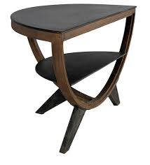 semi circle console table in brown black colour by the yellow door