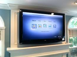 hanging tv over fireplace hang over fireplace hanging tv over stone fireplace