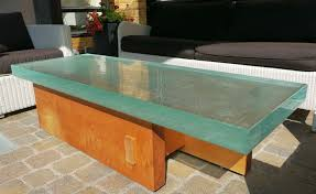 Great looking outside coffee table made of very thick glass on a custom  made spanish cedar wood base. Glass is 22