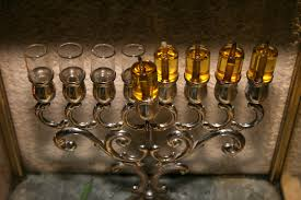on the first night we recite three brachot before lighting the menorah lehadlik ner shel chanukah on the mitzvah of lighting she asah nisim for the