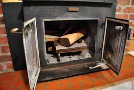 the beginning of a fireplace makeover removing a woodstove insert young house love