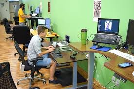 office desks for tall people. desk people working at desks along wall tall office chair for standing