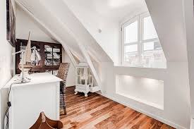 tiny home office in the attic with a lovely view outside the window from beautiful home office design ideas attic