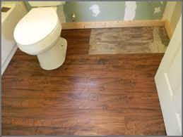 cozy bathroom with wooden floor by vinyl plank flooring for home ideas