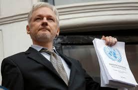 wikileaks bio news photos washington times julian assange holds a u n report as he speaks on the balcony of the ian embassy