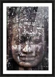 a face sculpture on a stone wall at angkor wat cambodia picture frame printing
