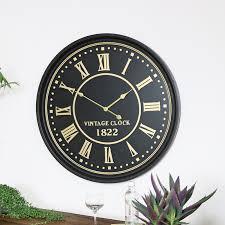 large black gold wall clock