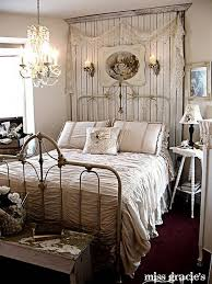 this is an example of a romantic shabby chic style bedroom with the chandelier and the