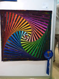 The first place quilt was colorful twisted Log Cabin. Description ... & The first place quilt was colorful twisted Log Cabin. Description from  dragonflyquilts.com. Adamdwight.com